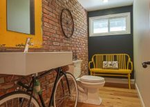 Industrial powder room with an old bicycle turned into a cool vanity 217x155 Trendy and Refreshing: Gray and Yellow Bathrooms That Delight