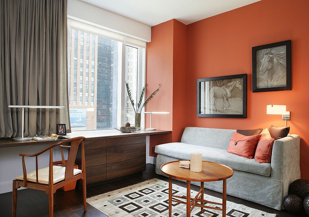 It is drapes and a space savvy couch that bring gray to this home office in orange and white [Design: Stedila Design]