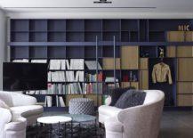 Large floor-to-ceiling open bookshelf in the living room