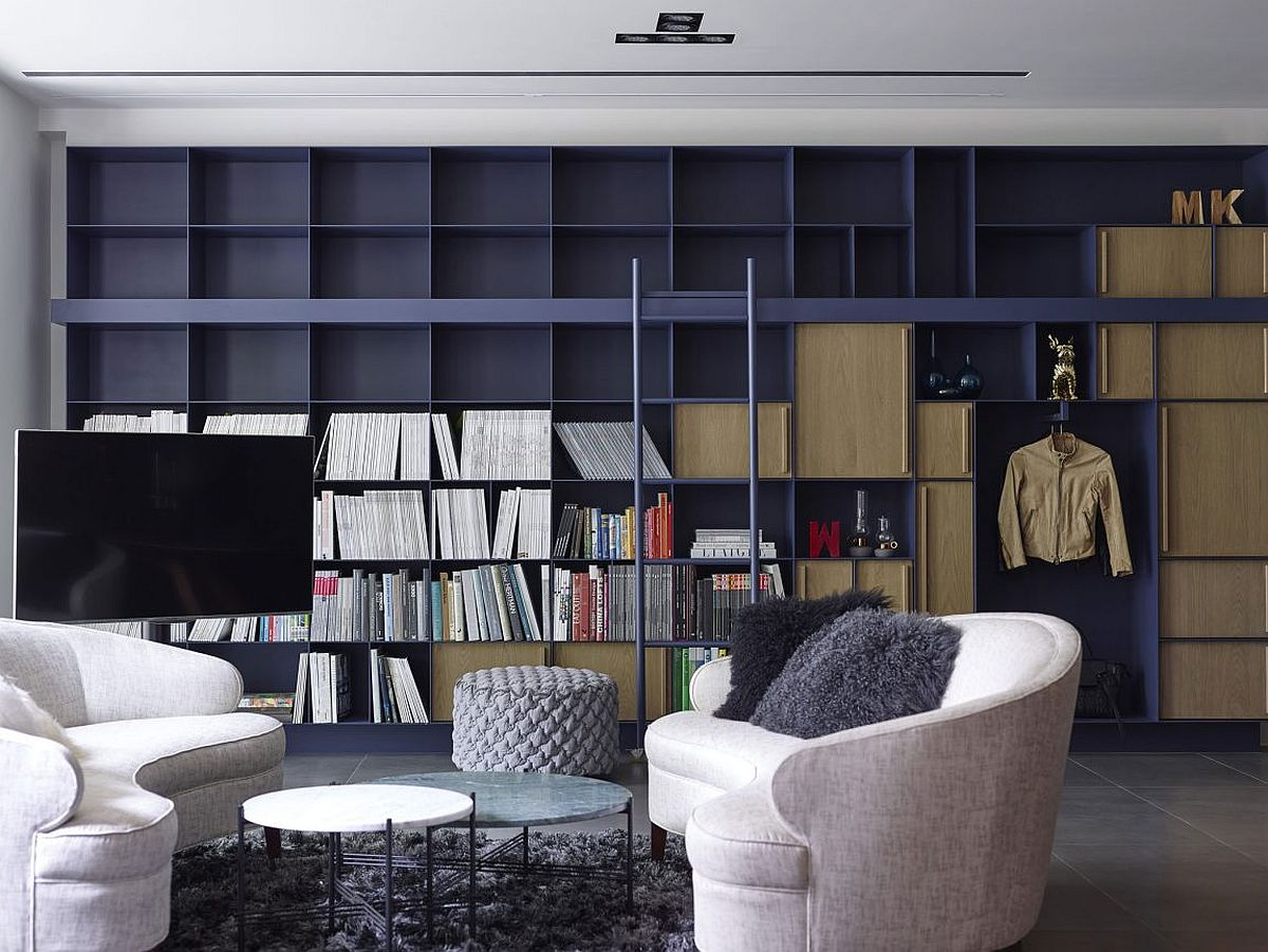 Large floor-to-ceiling open bookshelf in the living room