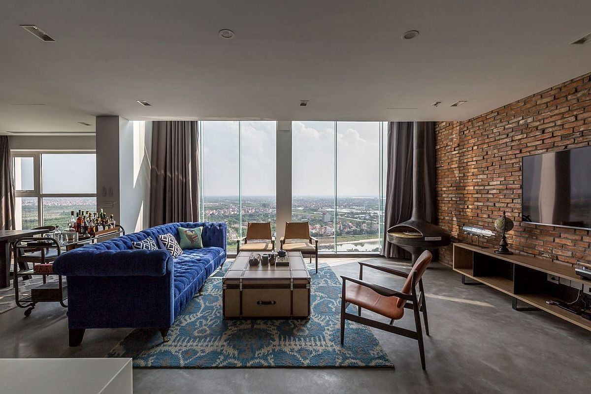 Large windows bring ample light into the living space of modern penthouse