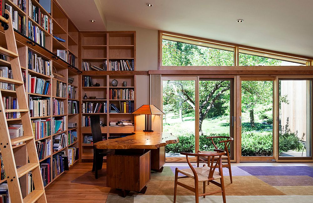 Library and home office rolled into one with smart shelving and a live edge table [Design: SALA Architects]