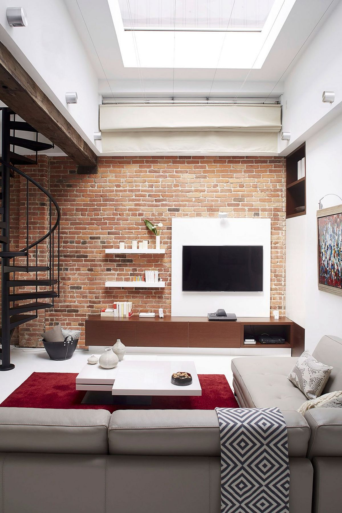 Living room entertainment unit with brick wall backdrop