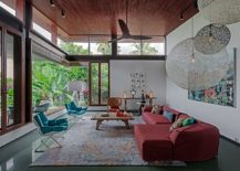 Living room with glass walls colorful furniture and large pendants from Moooi 217x155 House 1058: Series of Cantilevered Roofs and Gardens Offers Sheltered Hangouts
