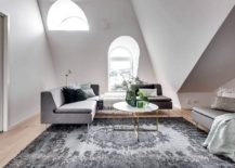 Low slung decor gives the living room a spacious visual appeal