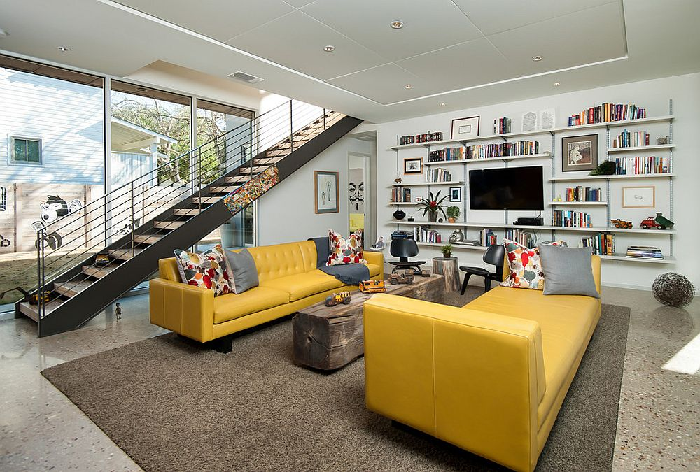 Midcentury living room with a yellow couch and lounger [Design: Foursquare Builders]
