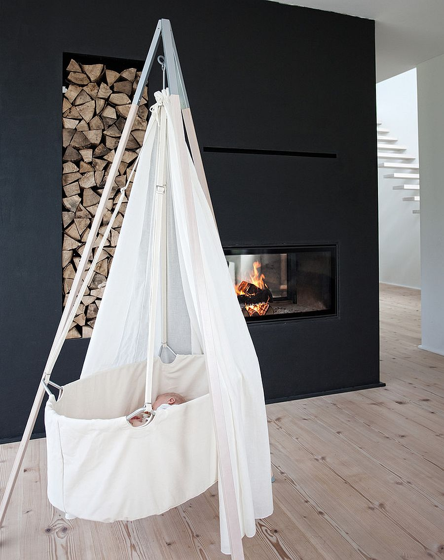 Minimal Scandinavian nursery design idea with fireplace [Design: Cuckooland]