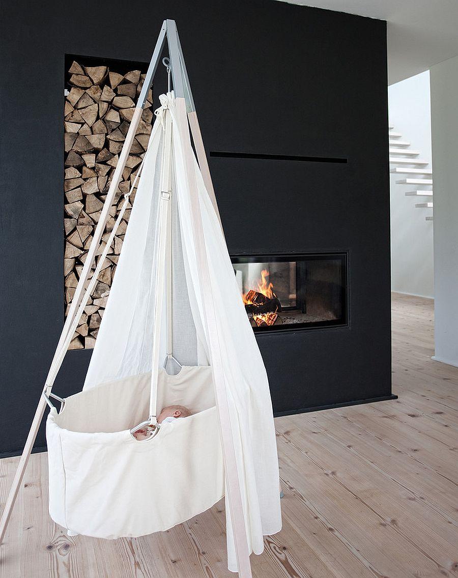 Minimal Scandinavian nursery design idea with fireplace [Design: Cuckooland]