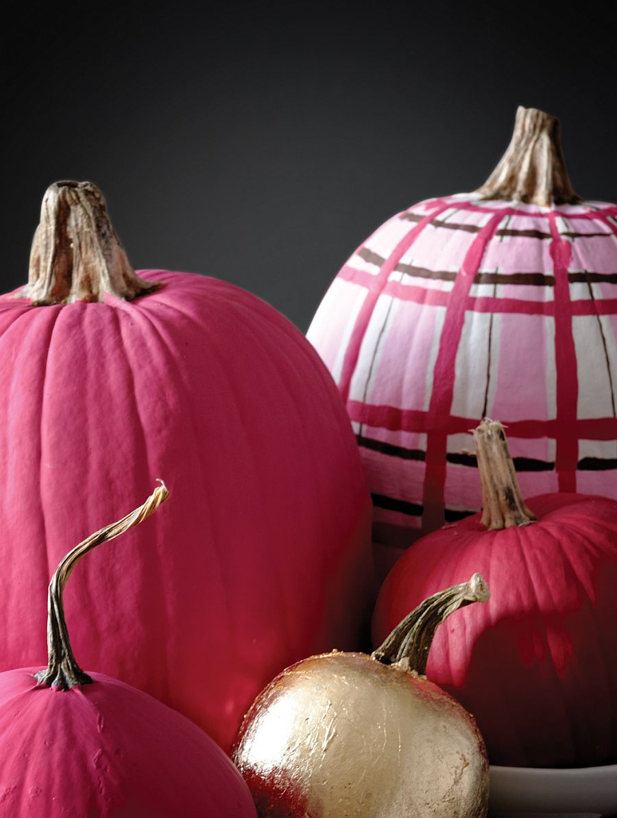 Mix different hues and patterns to create an eclectic collection of painted pumpkins this Halloween