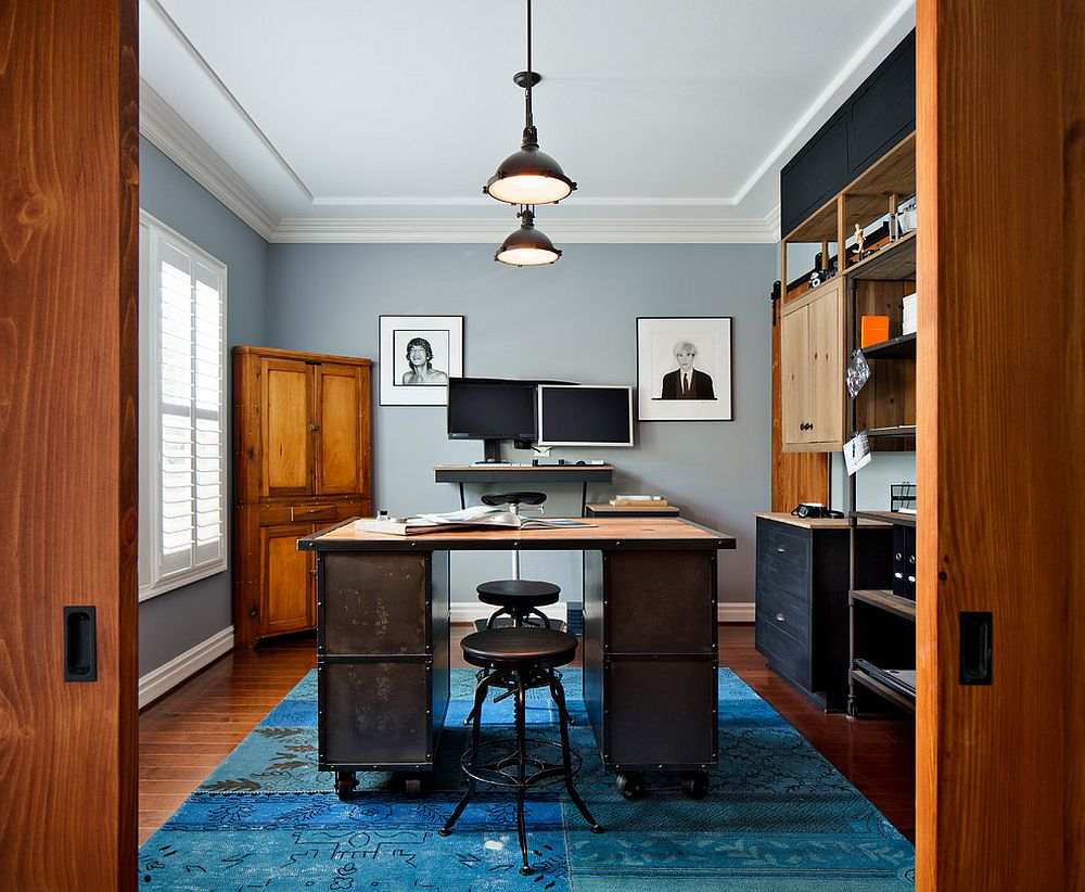 Modern industrial home office in gray with a bright blue rug [From: CM Natural Designs / Chipper Hatter]