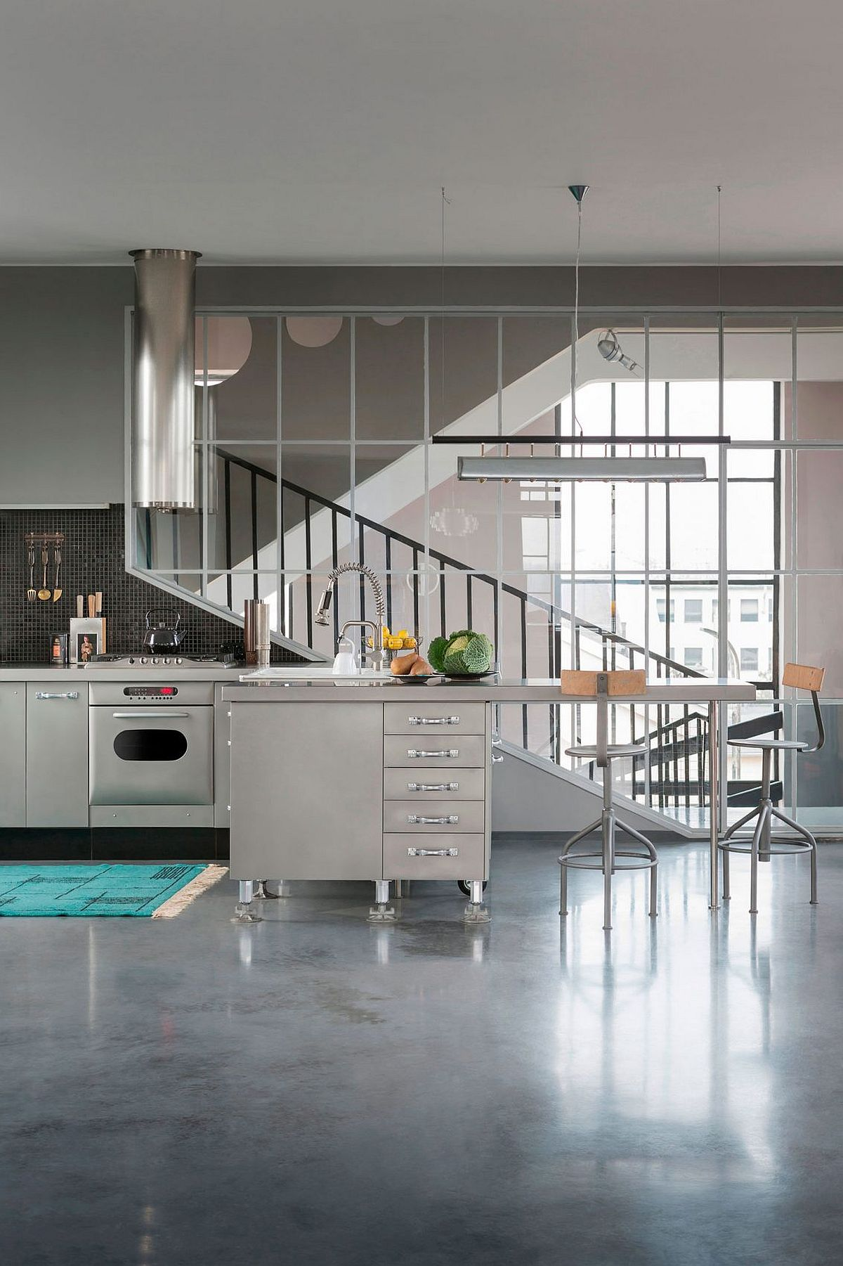 Modern industrial kitchen with a sparkle of stainless steel