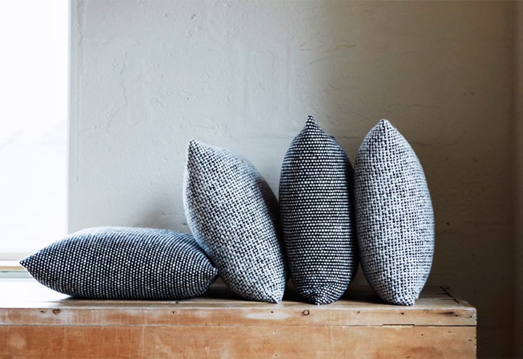 Mourne Tweed cushions designed by Gerd Hay-Edie for Mourne Textiles. Image via twentytwentyone.