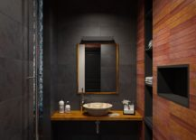 Nature slate and teak create a sophisticated and dashing contemporary bathroom