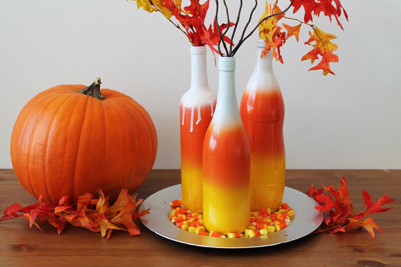Ombre wine bottles for a candy corn centerpiece