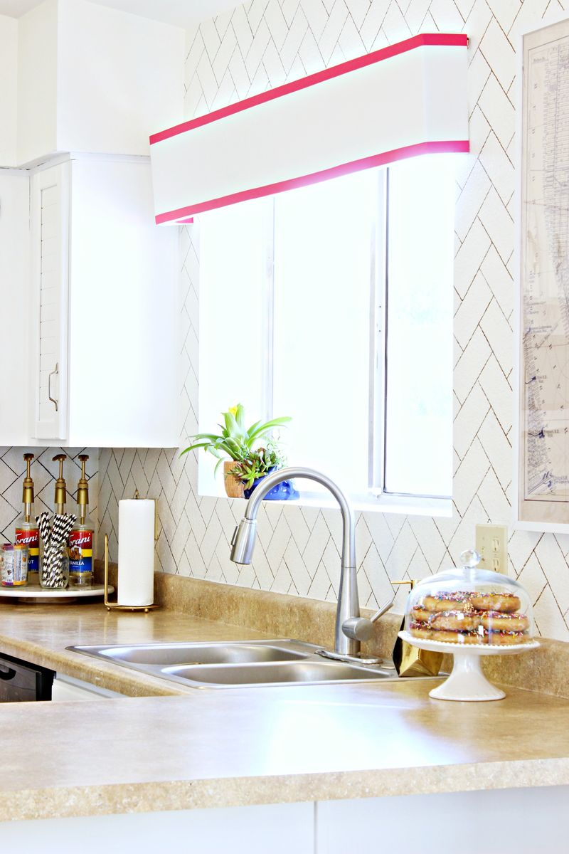 Painted herringbone backsplash from A Beautiful Mess