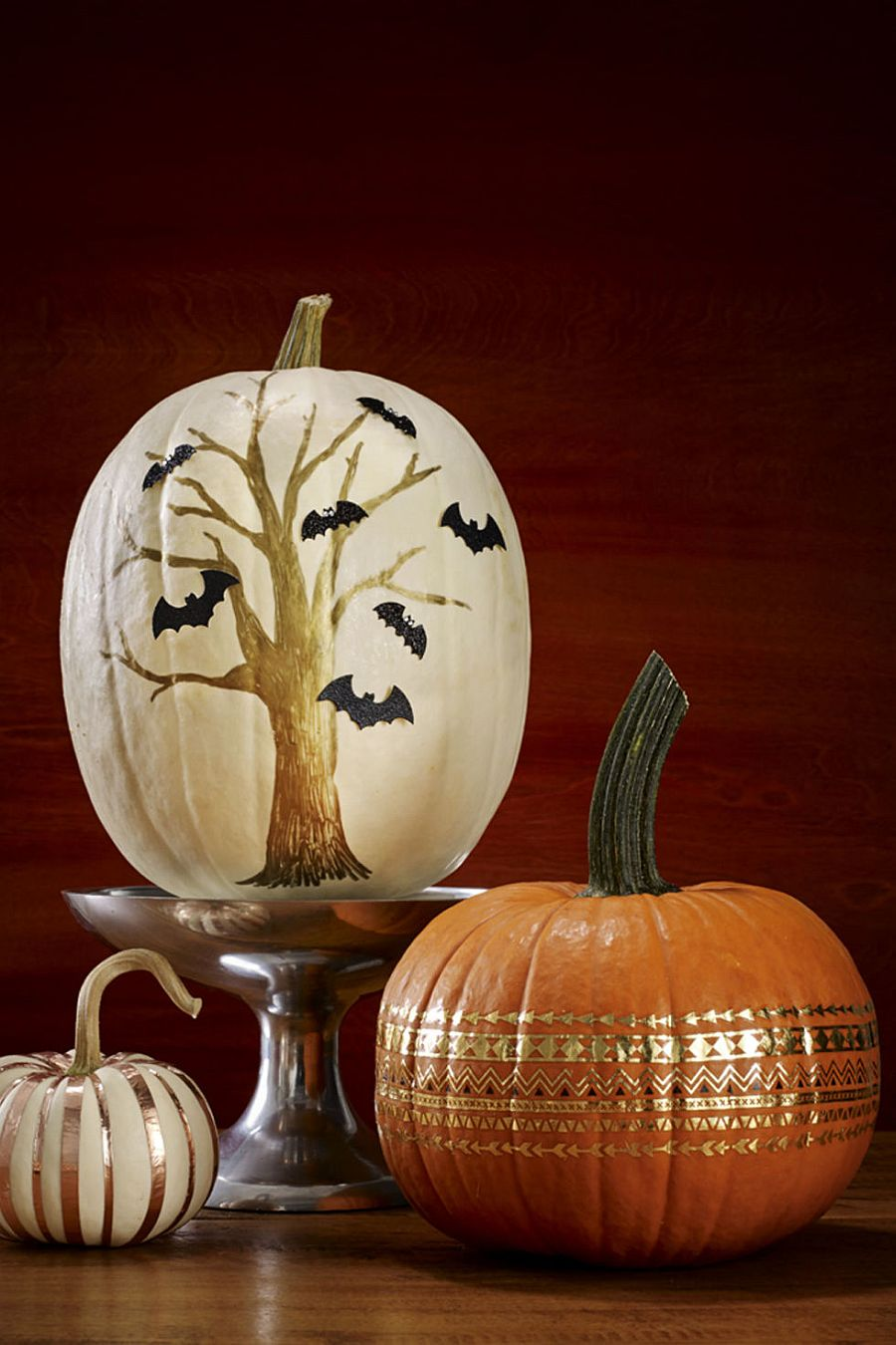 Painted pumpkin brings a touch of spooky charm to the Halloween setting