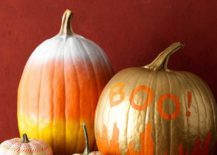 Painted pumpkins in gold and orange work well throughout the year