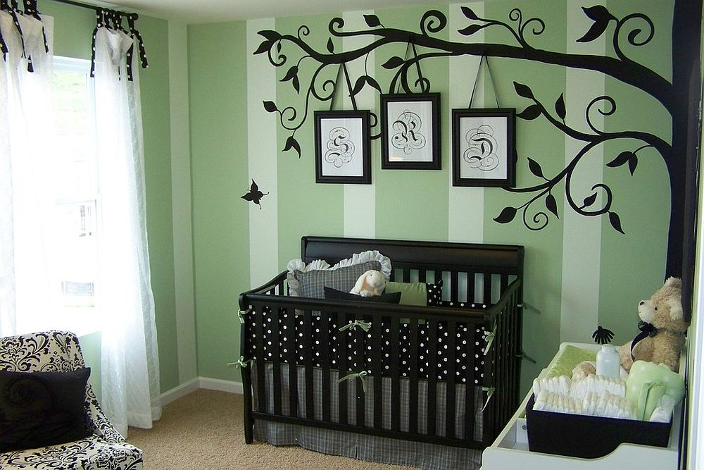 Painted tree in black defines this elegant nursery [Design: Anita Roll Murals]