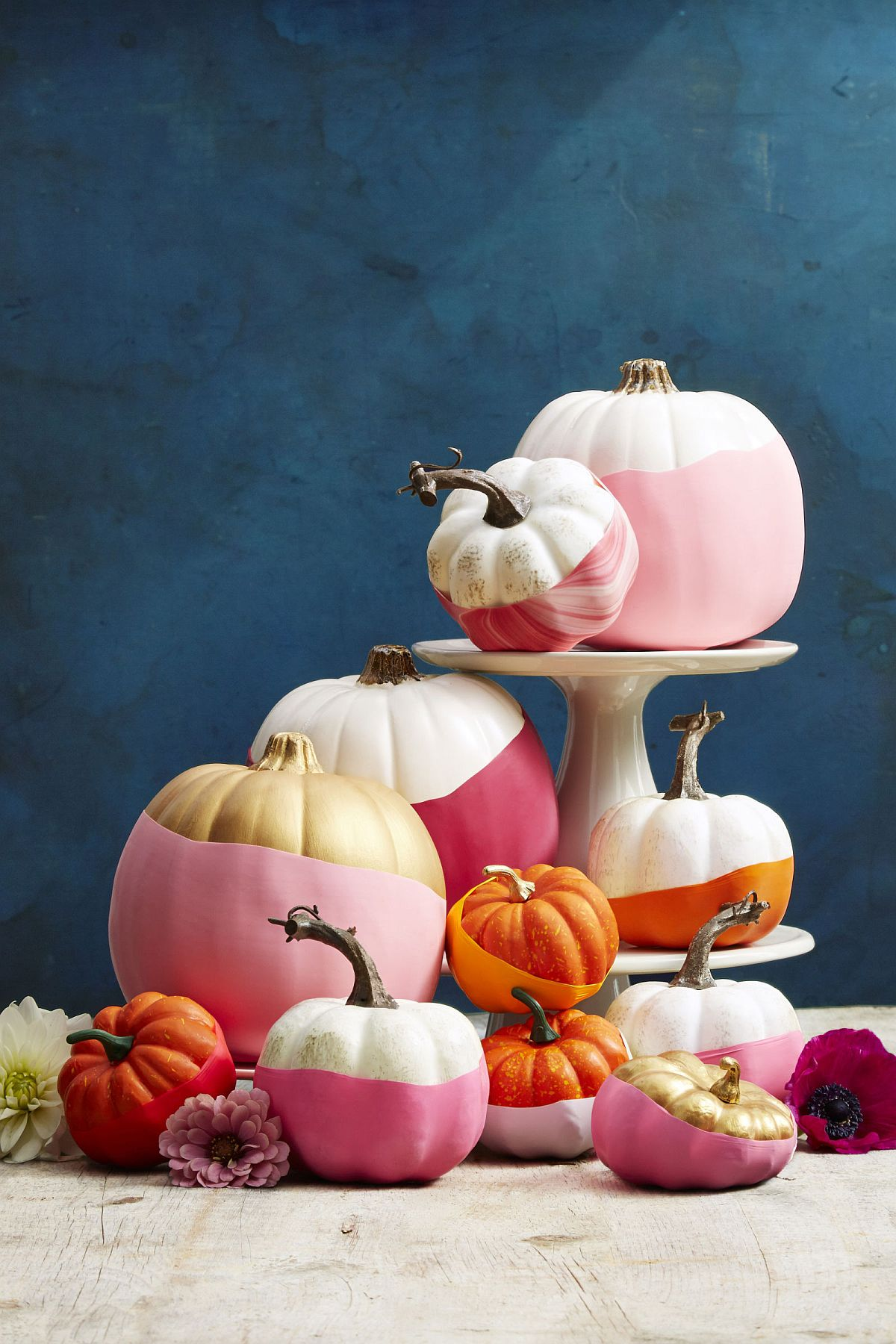 Pink gives chic glam to the awesome Halloween pumpkin decorative piece