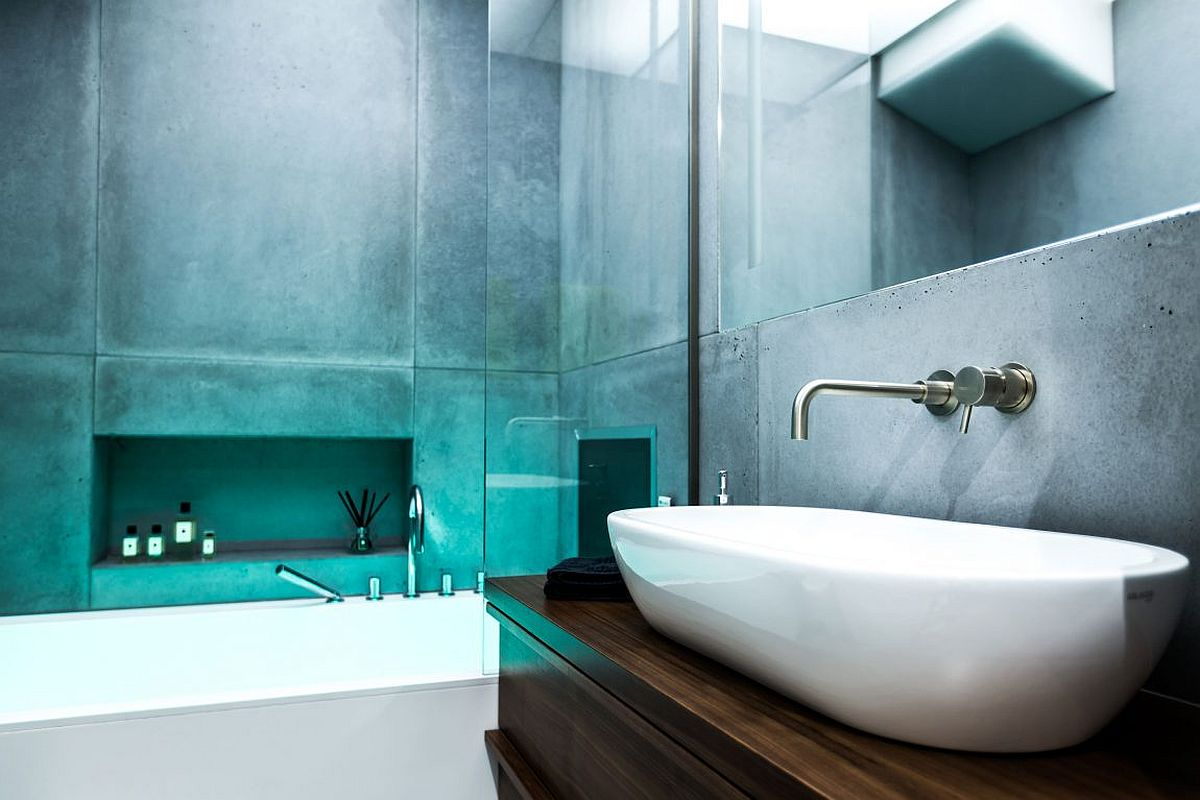 Plexiglass panels and lit ceiling give the contemporary bathroom a great ambiance