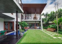 Pool and outdoor living spaces of the stylish home in Hyderabad