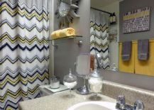 Pops of yellow enliven modern bathroom in gray