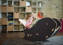 Quirky decor additions like the whale chair allow you to add black to the nursery in style