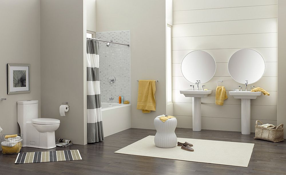Refined contemporary bathroom in gray with pops of yellow [Design: American Standard Brands]