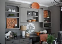 Refined contemporary home office in gray with pops of orange
