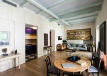 Restored and reinforced original ceiling beams of the modern apartment