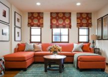 Rug adds subtle pattern to the living room with bold orange couch