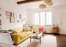 Scandinavian style living room lets the yellow couch become the star of the show