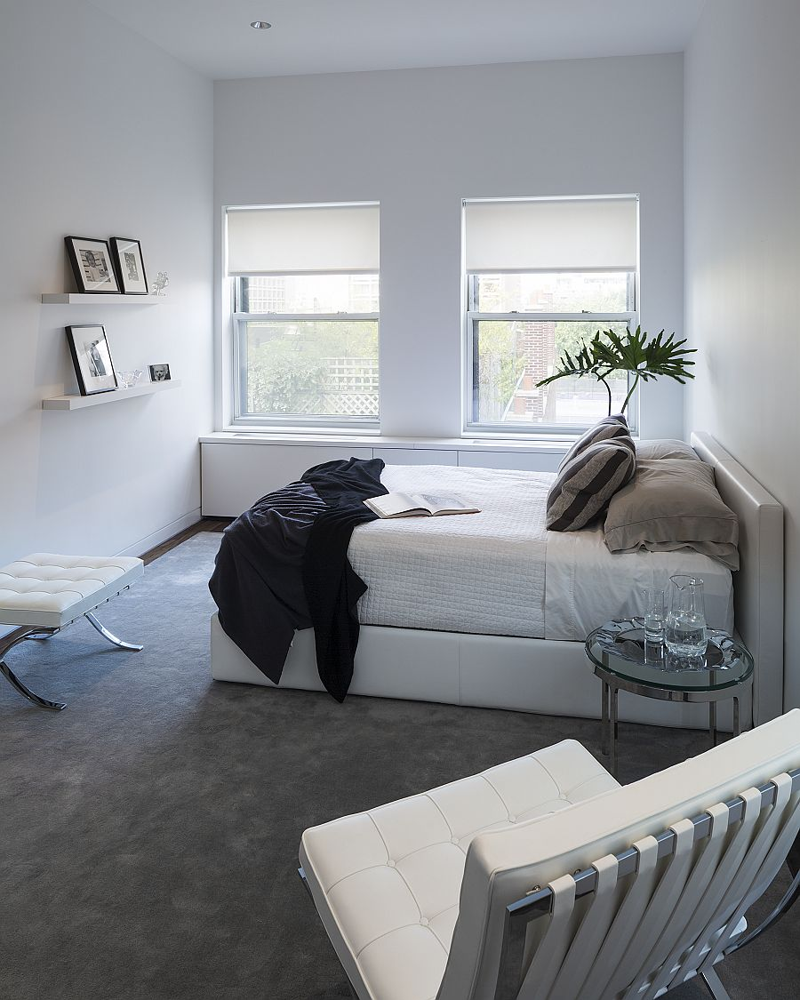 Serene white bedroom of the NoHo Loft