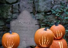 Skeleton-hands-carved-on-pumpkins-give-the-yard-a-cool-and-spooky-look-217x155