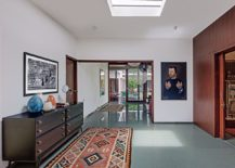 Skylight, traditional rugs and cool decor create a relaxing and light-filled interior