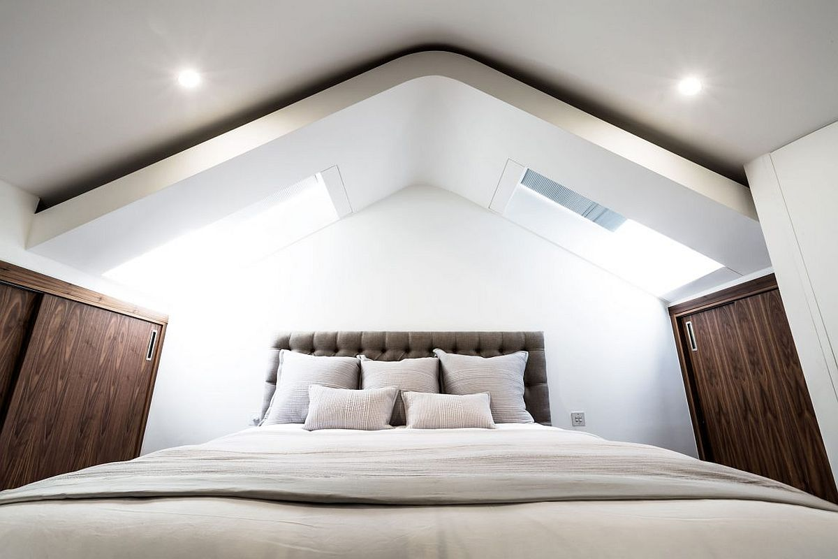 Skylights bring ample natural light into the mezzanine level bedroom