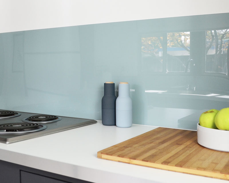 Sleek acrylic backsplash from fogmodern