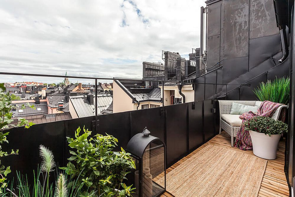 Small and comfy balcony of the stylish attic apartment