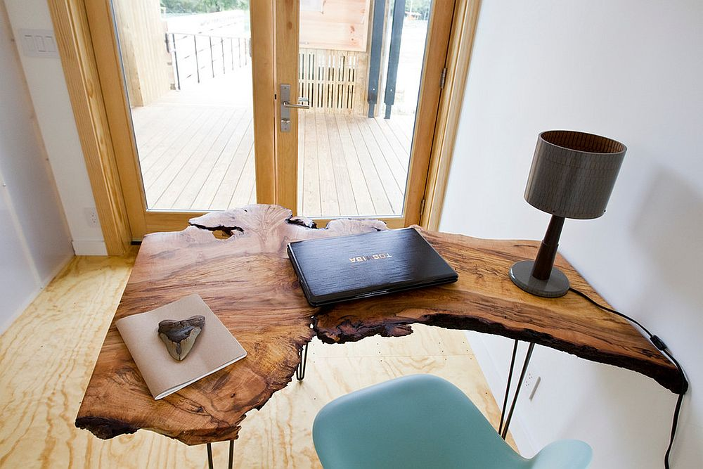 Small home office design with a stylish live edge table and comfy chair [Design: Bark House]
