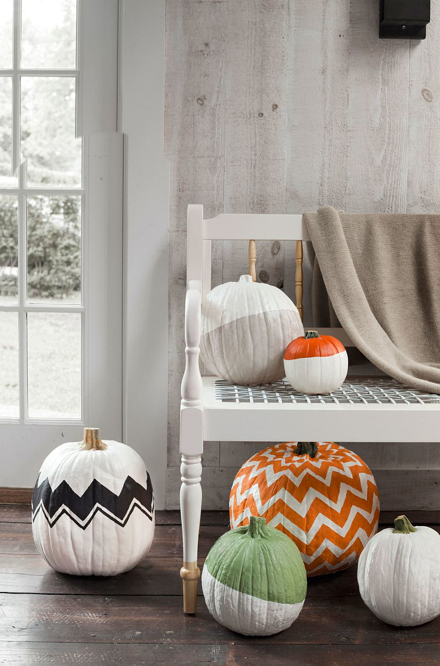 Snazzy and chic painted pumpkin idea for Halloween with geo style [From: Country Living]