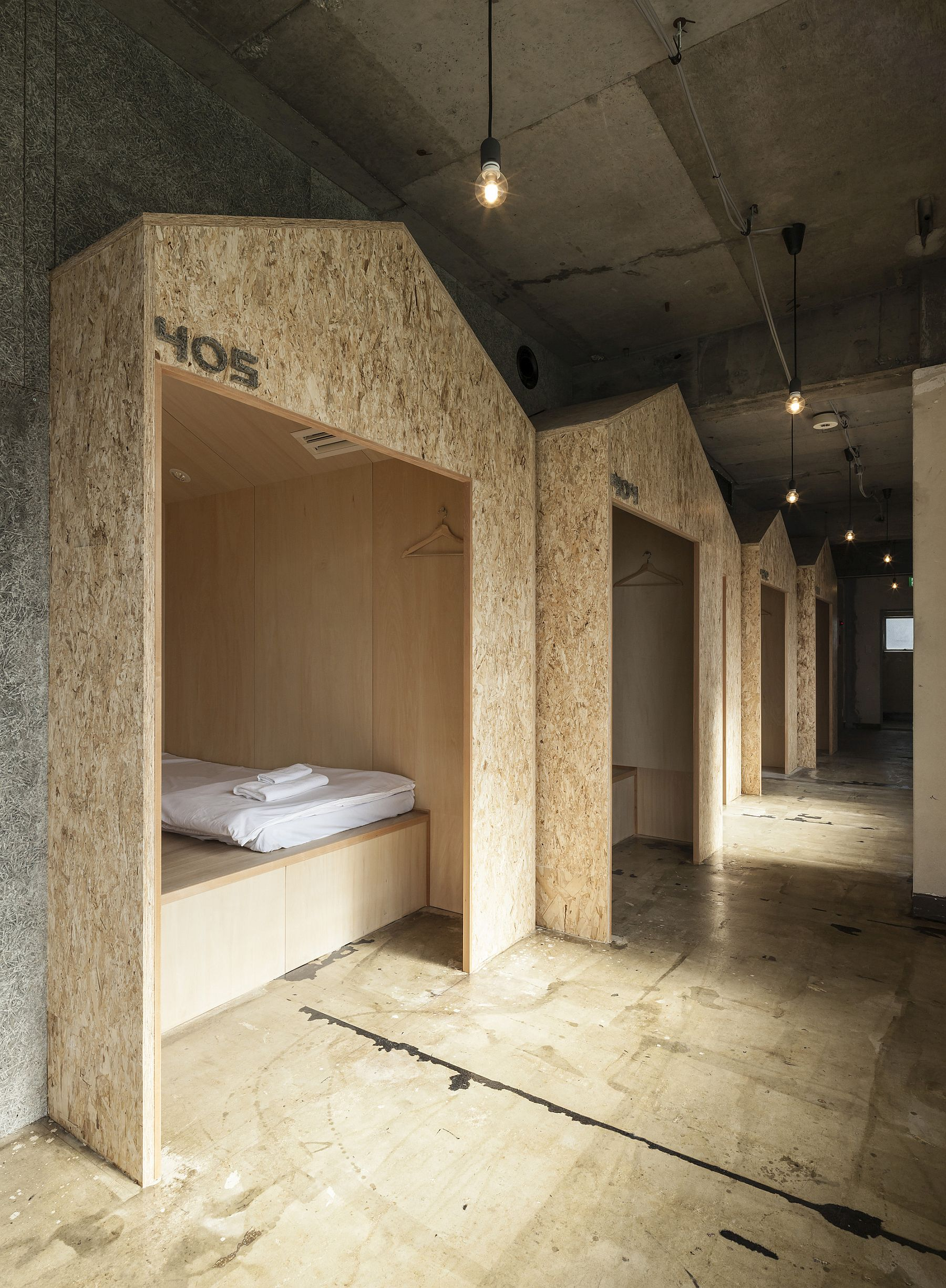 Space-savvy sleeping huts inside the Tokyo hostel