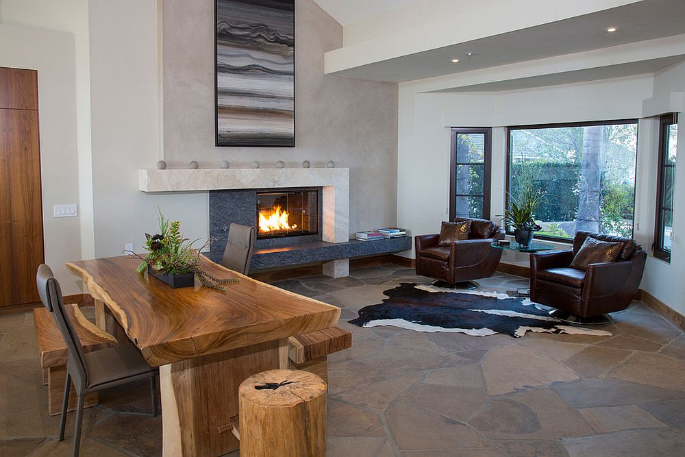 Spacious home office with fireplace and live edge table [Design: James Glover Residential & Interior Design]