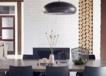 Stacked firewood adds textural beauty to the smart dining room