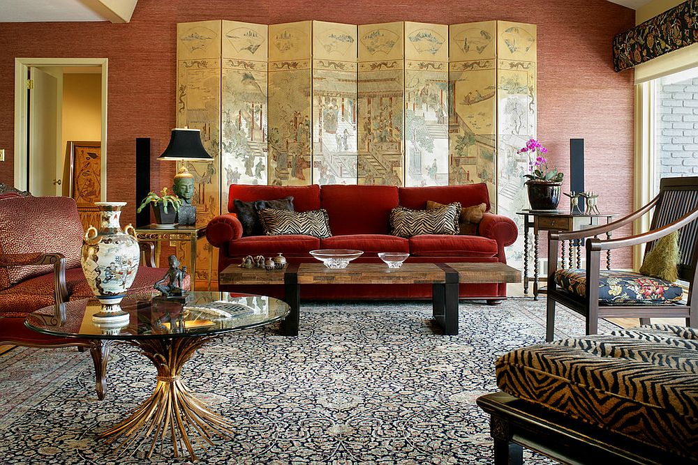 Stunning modern Asian living room with a Ralph Lauren red sofa and a gorgeous screen [Design: TSD Global Designs]