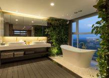 Stunning modern bathroom with standalone bathtub and living walls