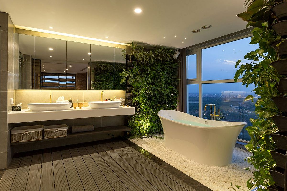 Stunning modern bathroom with standalone bathtub and living walls