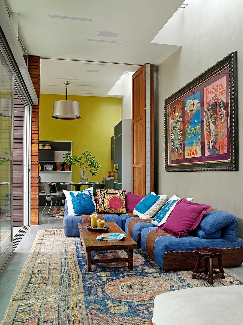 Stylish sofa brings color to the eclectic living room [Design: Katie Leede & Company Studio]