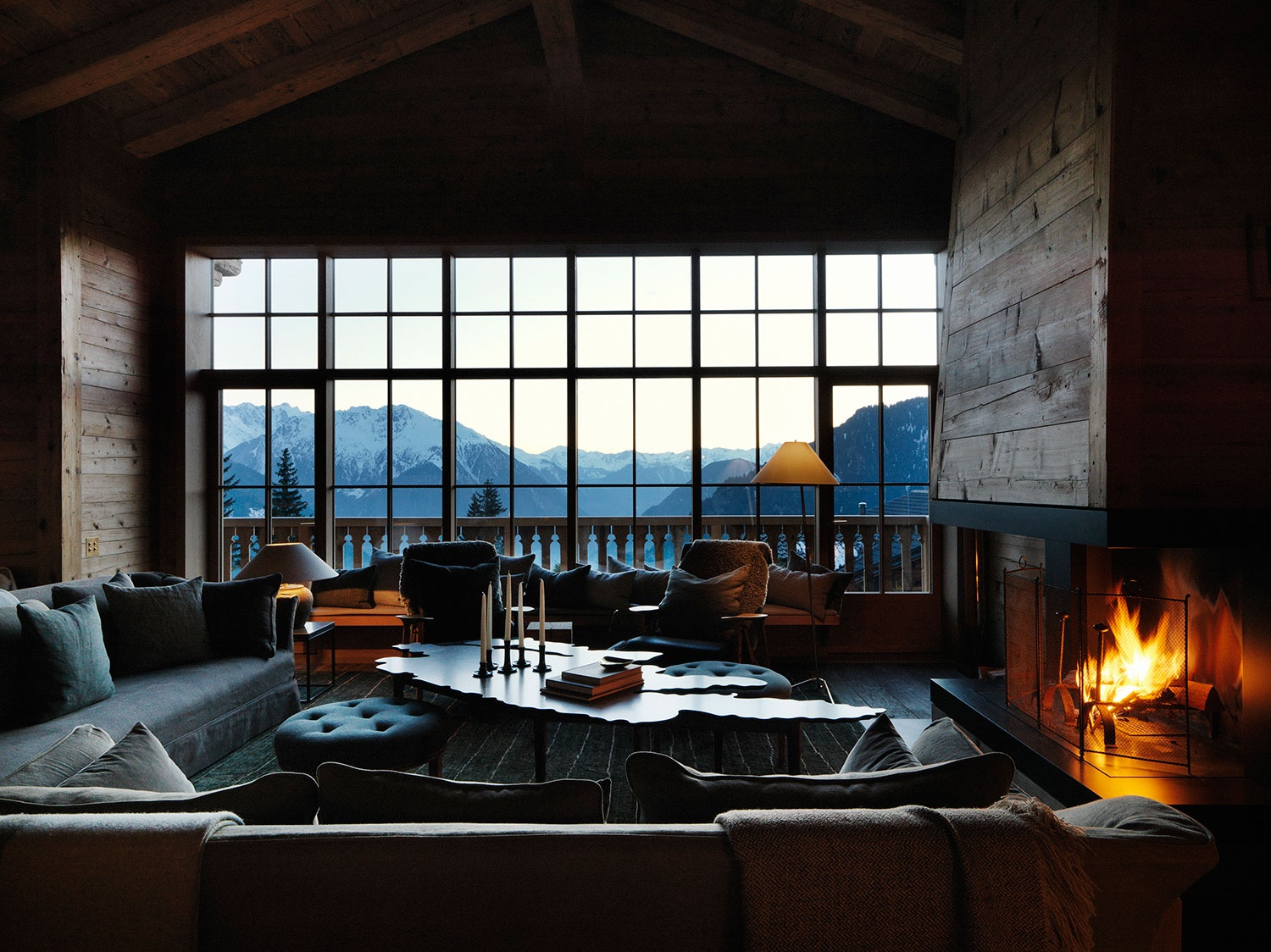 Using natural materials, layers of textile and sumptuous furniture, Ilse Crawford's Studioilse created this cosy chalet deep in the Swiss Alps. Image courtesy of Studioilse.