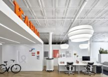 Tin ceiling and open interior create a spacious and cheerful office