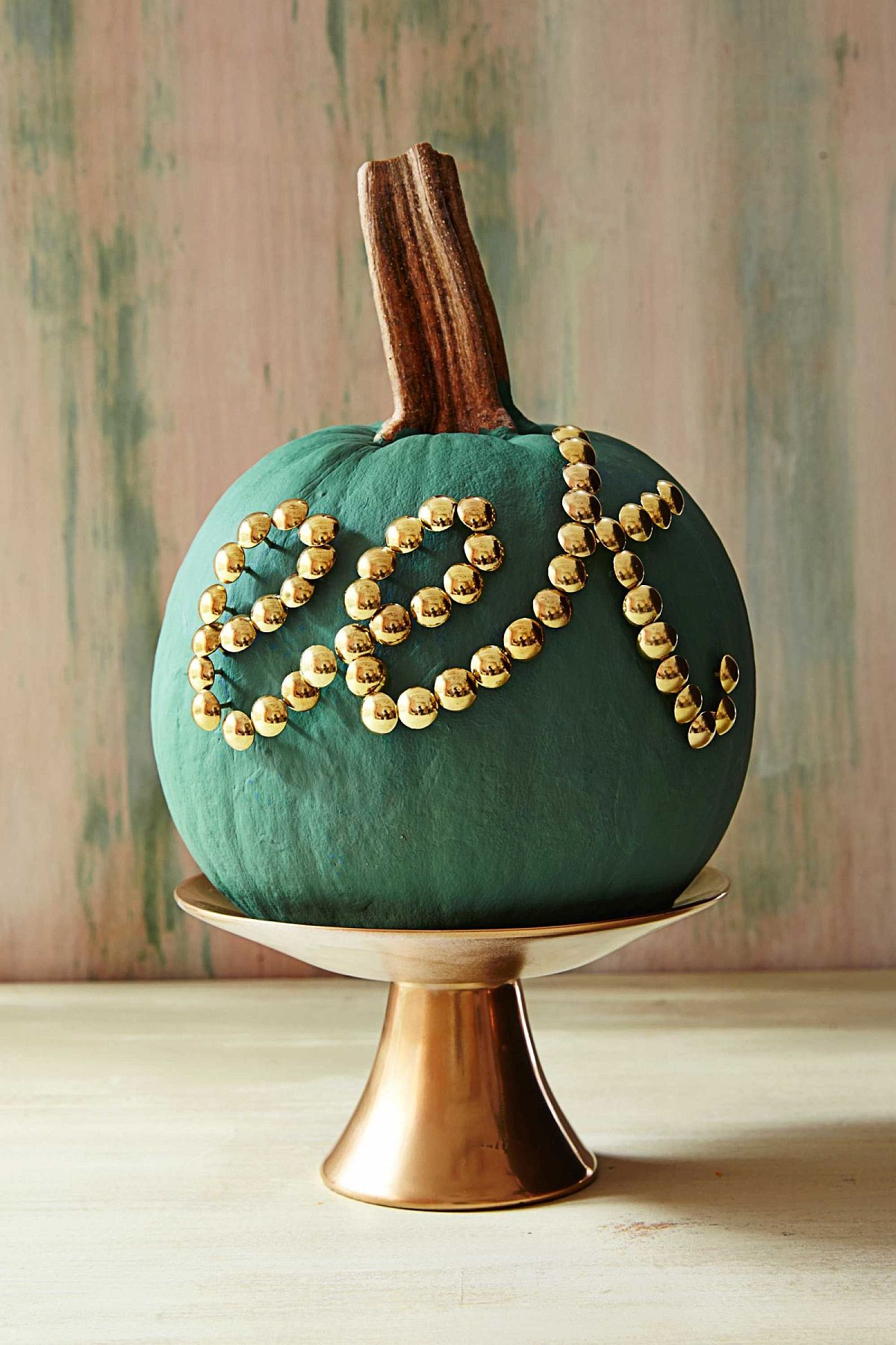 Touch of tacky color and pattern for the Halloween pumpkin [From: Annies Loan]